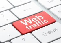 SEO web design concept: Web Traffic on computer keyboard backgro